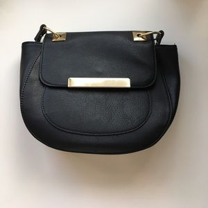Black cross body purse with gold details